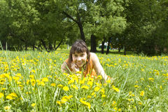 Lady with yellow dandelions Royalty Free Stock Photography