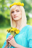 Lady with yellow flowers Stock Images