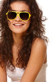 Lady in yellow glasses Stock Photography