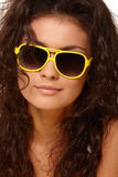 Lady in yellow glasses Royalty Free Stock Image