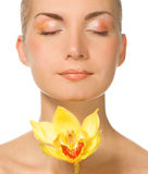Lady with yellow orchid Stock Photo