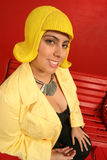 Lady in yellow wig. Playful lady in bright yellow wig on red background Stock Photo