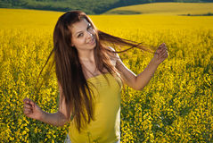 A lady in yellow Stock Images