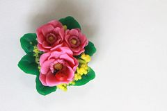 Ladybird, bouquet of flowers, souvenir soap, souvenir, gif. Cute souvenir with a bouquet of red and yellow flowers and ladybug Stock Photo