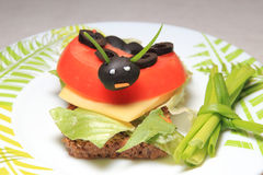 The ladybird. A ladybird made from olives and tomato. A food for children Royalty Free Stock Image