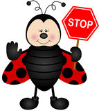 Ladybird with a street stop sign Royalty Free Stock Photos