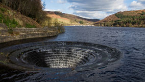 Ladybower reservoir overflow. Ladybower Reservoir is a large Y-shaped reservoir, the lowest of three in the Upper Derwent Valley in the Peak District National Royalty Free Stock Photos