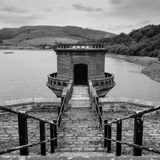 Ladybower Reservoir Tower. Water Tower Ladybower Reservoir Derbyshire. Steps leading down to water tower. Square crop image in black and white Royalty Free Stock Photos