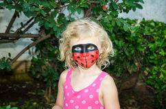 Ladybug face painting Royalty Free Stock Image