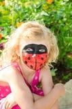 Ladybug face painting Stock Photos