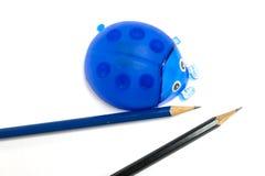 Ladybug pencil sharpener and pencil shavings Royalty Free Stock Photography