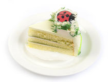 Ladybug on piece of cake. Royalty Free Stock Photos
