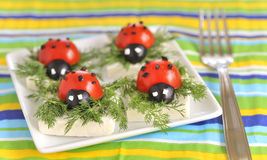 Ladybug tomato and olive with cheese Stock Images