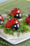 Ladybug tomato and olive with cheese Stock Image