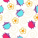 Ladybugs and flowers seamless vector pattern. Royalty Free Stock Image