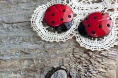 Ladybugs on an old napkin Stock Photo