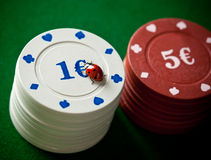 Ladybugs with poker chips Royalty Free Stock Image