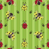 Ladybugs. Red and yellow. Seamless pattern. Ladybug on the striped background, the character from children`s cartoons. Design for textiles, tapestries Stock Photos