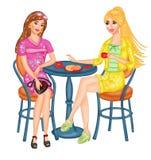 Ladyes jovenes que gozan de un café Fotografía de archivo libre de regalías