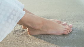 Ladys feet washed by waves stock video footage