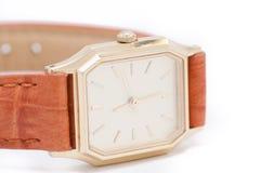 Ladys goldene Uhr Lizenzfreie Stockfotos