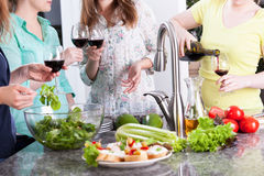 Ladys spending time in kitchen Royalty Free Stock Photography