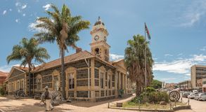 Town hall and cannons from the Boer War, in Ladysmith. LADYSMITH, SOUTH AFRICA - MARCH 21, 2018: A street scene, with the historic town hall and cannons from the Royalty Free Stock Image