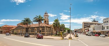 Town hall and cannons from the Boer War, in Ladysmith. LADYSMITH, SOUTH AFRICA - MARCH 21, 2018: A street scene, with the historic town hall and cannons from the Stock Image