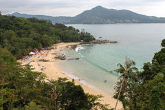 LAEM SINGH BEACH, THAILAND - NOVEMBER 07, 2013: View from viewpoint, full of relaxing people, between Surin and Kamala Royalty Free Stock Images
