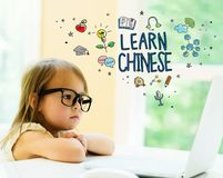 Laen Chinese text with little girl. Learn Chinese text with little girl using her laptop Stock Photography