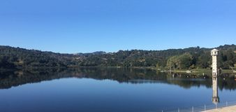 Lafayette Reservoir, California. With reflection and tower on clear day Stock Photography