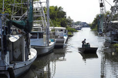 Lafitte Bayou. A fisherman heads out in his small bateau along a bayou in Lafitte, Louisiana Stock Photo