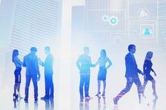Lag av affärsfolk, digital manöverenhet royaltyfria bilder