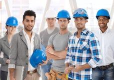 Lag av olikt folk från byggnadsbransch arkivfoton