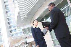 lag för kontor för byggnadsaffär olikt Arkivfoto