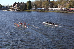 Laga left UMass Amherst right races in the Head of Charles Regatta Men`s College Eights. BOSTON - OCTOBER 22, 2016: Laga left UMass Amherst right races in the Royalty Free Stock Image