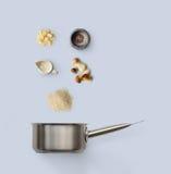 Laga mat ingredienser, italiensk risotto med lösa champinjoner som isoleras på blått Royaltyfria Bilder