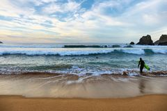 Surfer at sunset in Laga beach, Basque country, spain. stock photography
