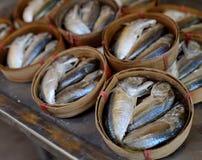 Lagad mat fisk i trummor Fotografering för Bildbyråer