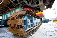 Lagarta da máquina escavadora da mineração imagem de stock