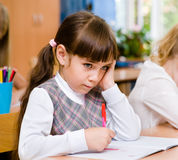 Lage schoolleerling tijdens het examen Royalty-vrije Stock Afbeelding