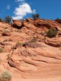 Lagen op een rood zandsteenklip Royalty-vrije Stock Foto's
