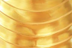 Lager av guld- horisontallinjer abstrakt bakgrund för modelltextur royaltyfria foton