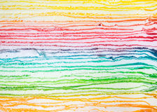 Lager av regnbågekräppkakan Arkivbild