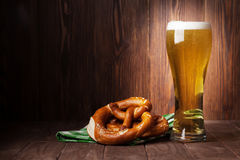 Lager beer glass and pretzel. On wooden table. View with copy space Royalty Free Stock Image