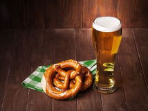 Lager beer glass and pretzel Stock Image