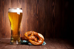 Lager beer glass and pretzel Stock Photography