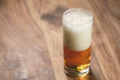 Lager beer in glass on wood board Stock Photography