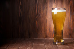 Lager beer glass. On wooden table. View with copy space Royalty Free Stock Image