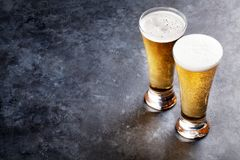 Lager beer glasses. On stone table. With copy space Royalty Free Stock Photos